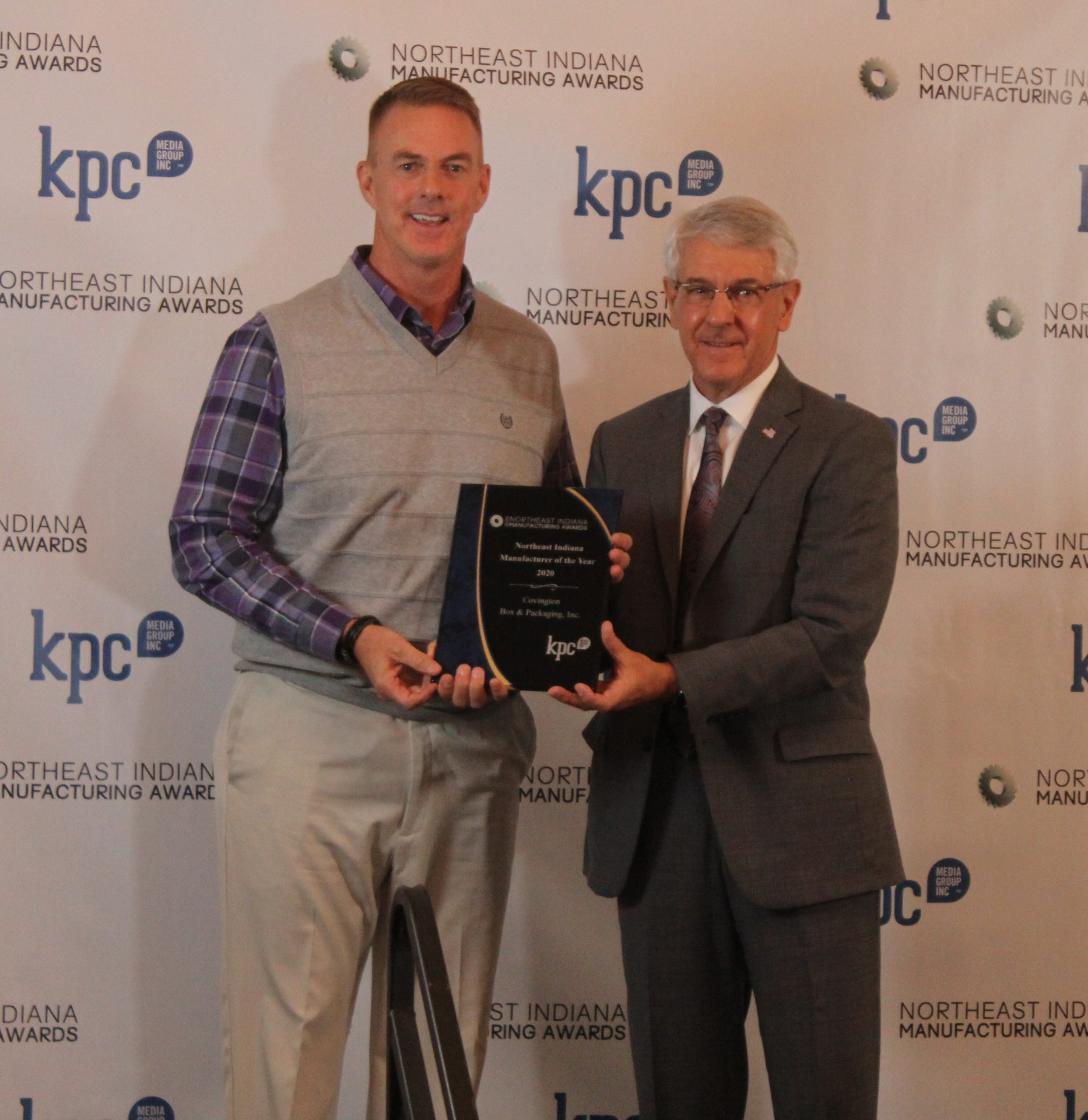 John Sampson, President and CEO of the Regional Partnership of Northeast Indiana, presenting the Northeast Indiana Manufacturer of the Year Award to  Covington Box & Packaging, Inc.