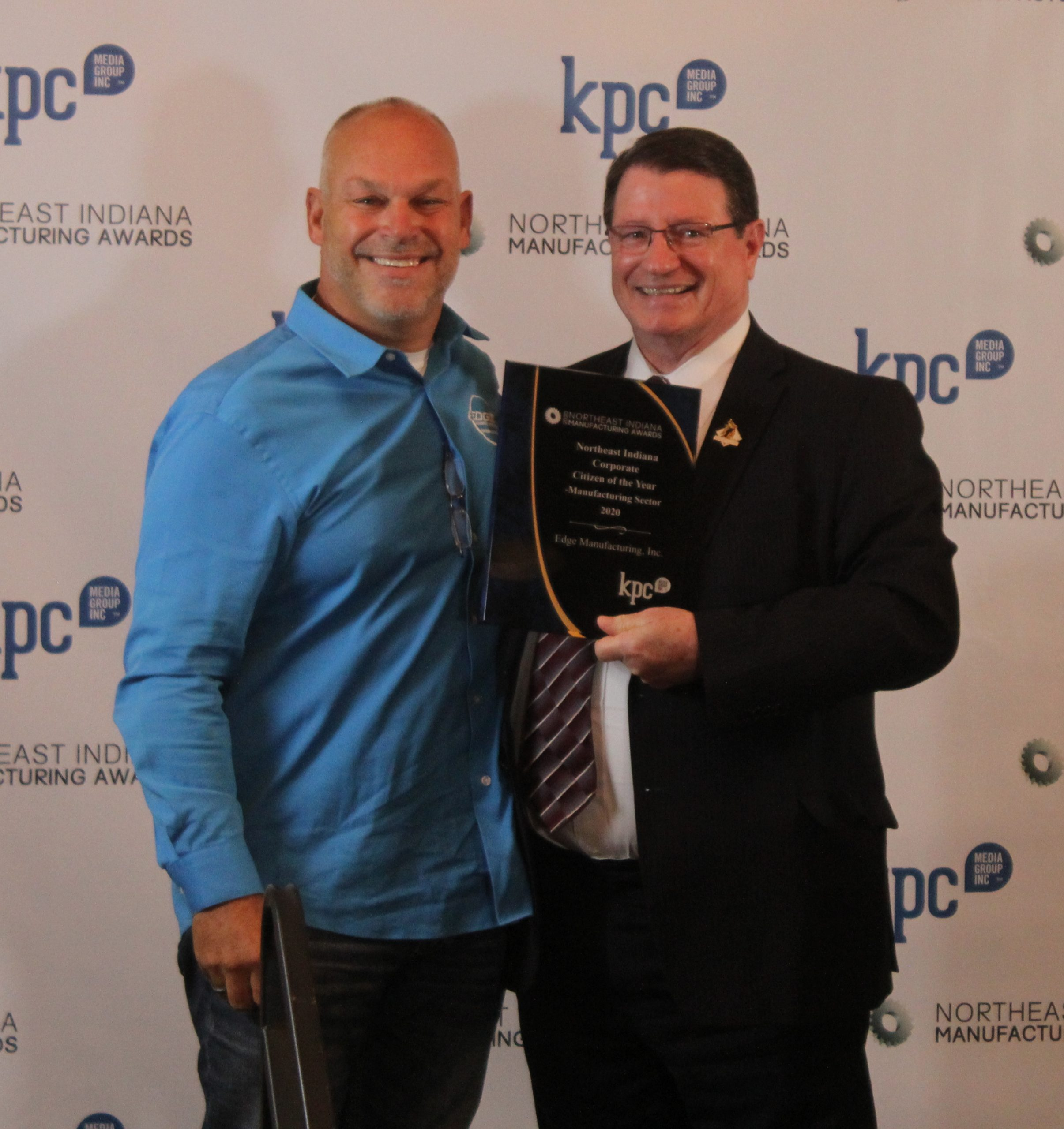 Bill Konyha, President and CEO of the Regional Chamber of Northeast Indiana Indiana, presenting the Corporate Citizen of the Year Award to  EDGE Manufacturing, Inc.
