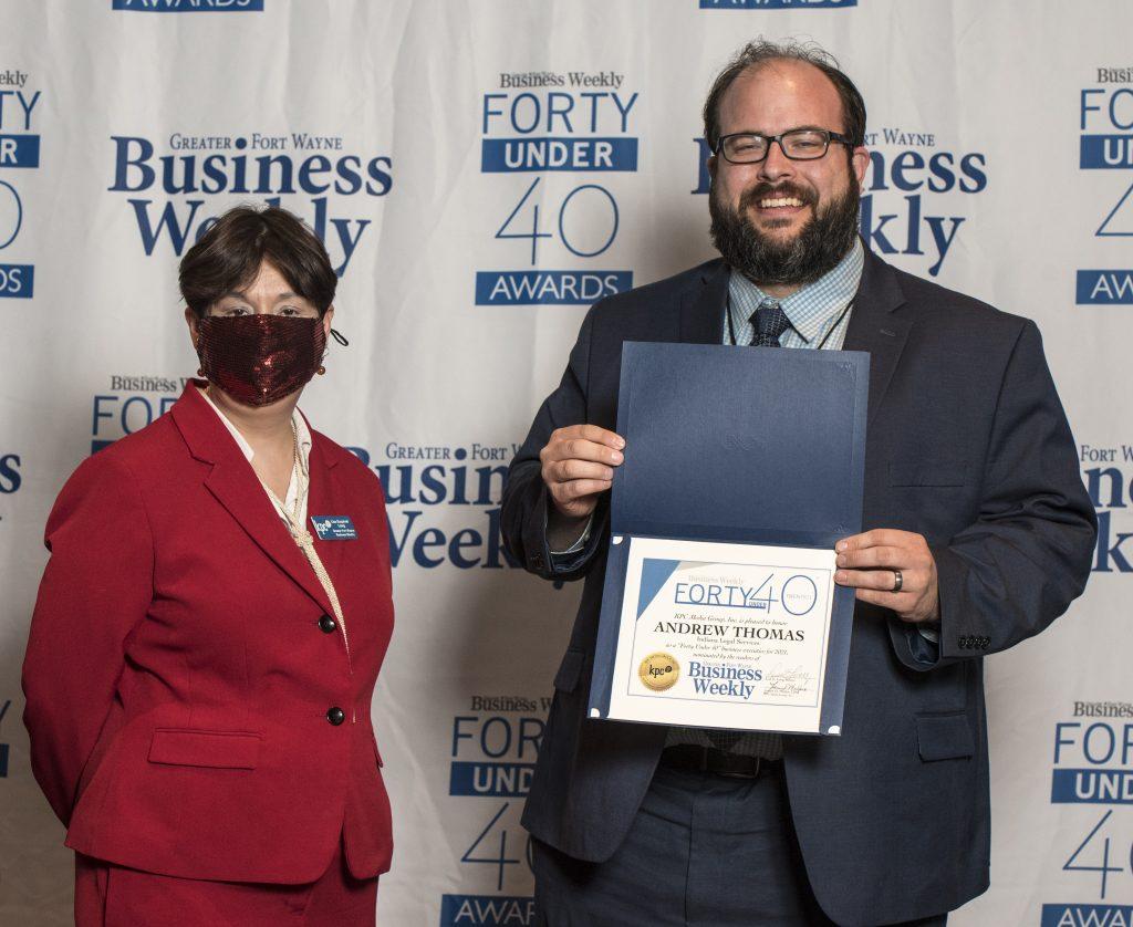 Andrew Thomas accepts his award