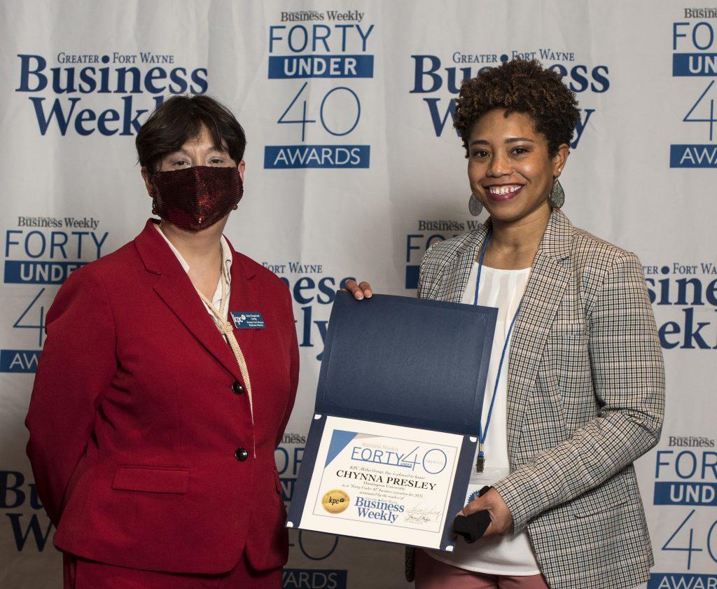 Chynna Presley from Title Sponsor Huntington University accepts her award.