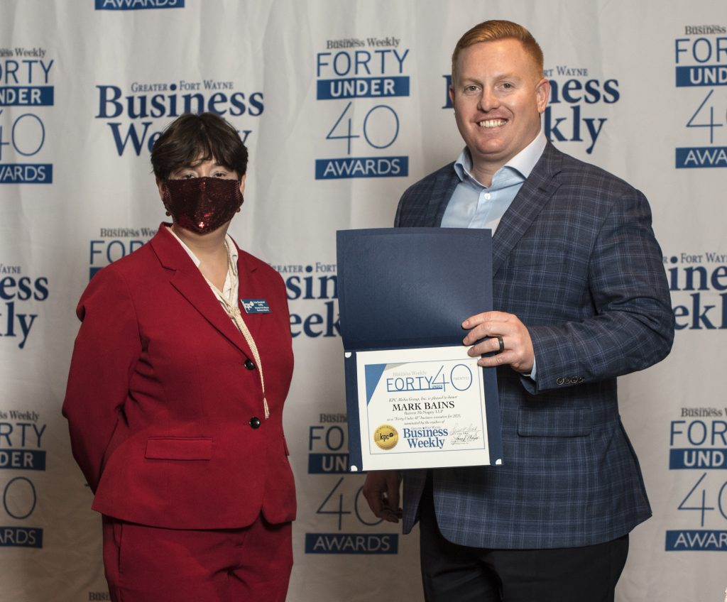 Mark Bains accepting his award.