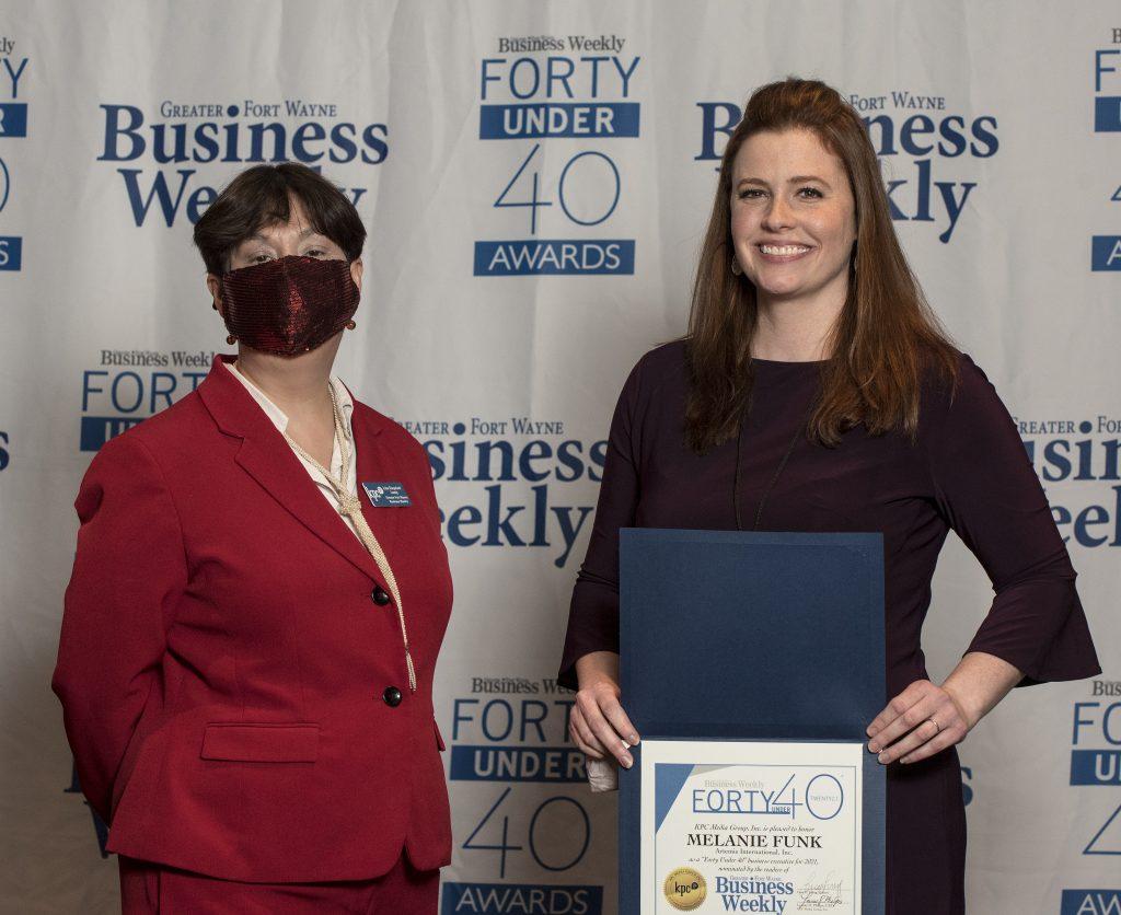 Melanie Funk, with Gold Sponsor Artemis International, accepting her award.