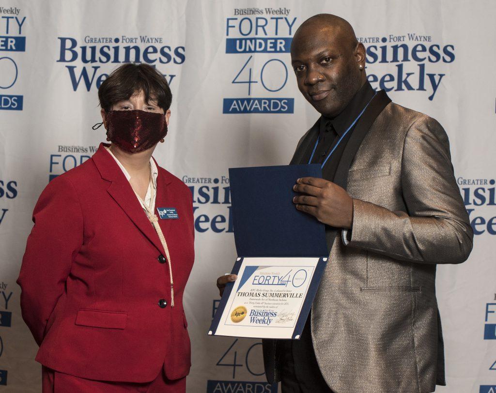 Thomas Summerville Jr. accepts his award